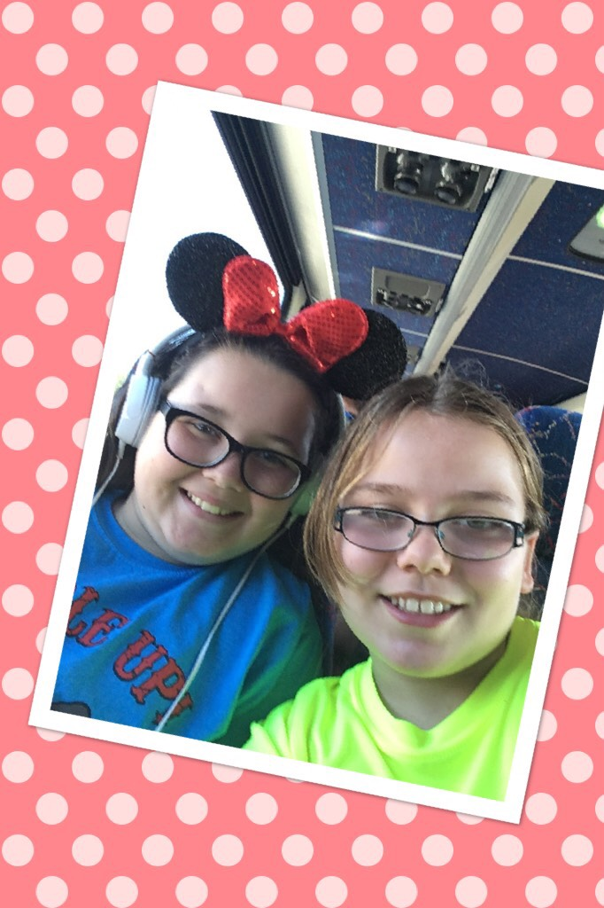 Me and my friend in the Minnie ears are going to Epcot